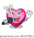 Singing heart box above wooden cartoon table 48167861