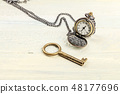 A photo of a vintage key and chain watch, with copy space 48177696