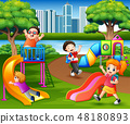 Happy children playing in the school playground 48180893