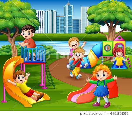 Happy children playing in the school playground 48180895