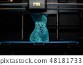 3d printer prints the model of female body, process of creating a bust of girl on 3d printer. 48181733
