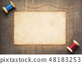 sewing thread on wooden table 48183253