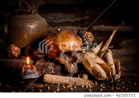 Human skull and candle with on wooden floor  48185751