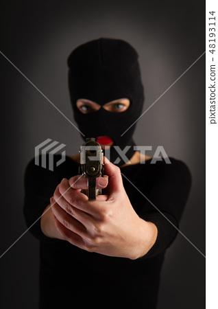 Girl in Black with Gun 48193114