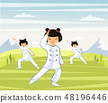 Girls are engaged in Taichi and qigong in a mounta 48196446