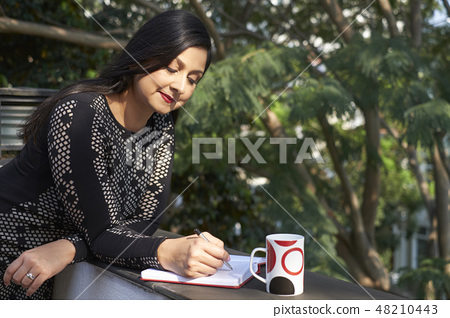 Business lady checking planner 48210443
