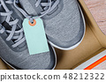 New blue sneakers with blank paper tag in box. 48212322