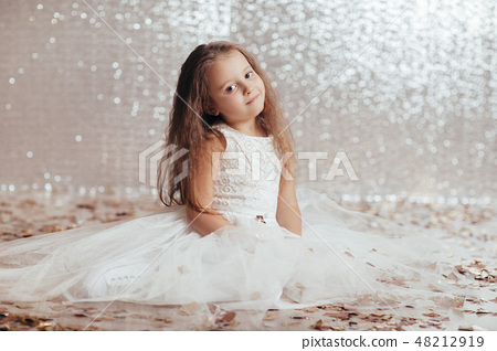 little child girl in princess dress on confetti background 48212919