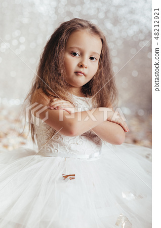 little child girl in princess dress on confetti background 48212921