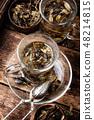 Cup of herbal tea 48214815