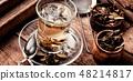 Herbal tea on wooden table 48214817