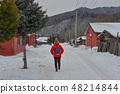People walking on street of mountain town 48214844