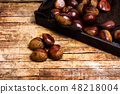 Fresh chestnuts on a wooden table 48218004