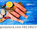 Salmon fish meat on a cutting board 48218023