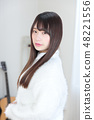 Young lady's hair style 48221556