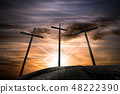Three crosses on a dramatic sky at sunset 48222390