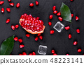 Ripe pomegranate fruits on the wooden background 48223141