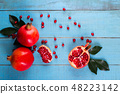 Ripe pomegranate fruits on the wooden background 48223142