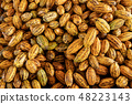 Cocoa beans and cocoa pod on a wooden surface 48223143