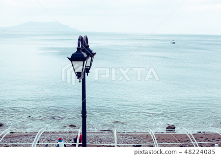 Beautiful authentic lantern on the seafront of the Black Sea in Crimea 48224085