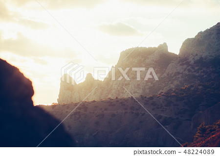 Sunset in the mountains in backlight. Crimea, the village Novyi Svet 48224089