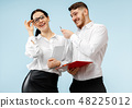 Concept of partnership in business. Young man and woman standing at studio 48225012
