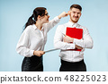 angry businesswoman and colleague in the office. 48225023