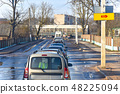 Cars stand in front of the railway crossing  48225094