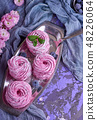 round pieces of pink marshmallows on an iron plate 48226064
