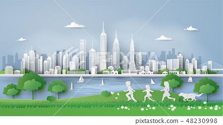 children running in the city park 48230998