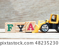 Toy bulldozer hold letter block A to word FYA 48235230