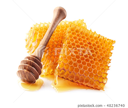 Honeycomb with spoon in closeup 48236740