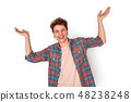 Teenager with earrings studio standing isolated on white hands aside laughing joyful 48238248