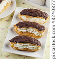 Homemade eclair choux pastry with chocolate. 48240877