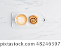 Freshly baked cinnamon roll and coffee 48246397