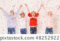 Happy children throwing confetti against light background 48252922