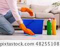 Woman with obsessive compulsive disorder cleaning floor 48255108