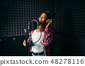 Female performer songs in audio recording studio 48278116