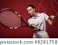 Game, Set, Match Young tennis player standing isolated over red background with a racket and a ball 48281758