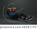 Strong body. Sportsman lying over dark background, working abs 48281795