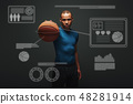 Keep it up. Handsome sportsman standing over dark background with basketball ball in his hand 48281914