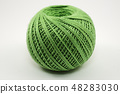 a skein of green wool on a white 48283030