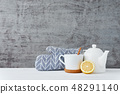 Ceramic teapot, white cup and lemon 48291140