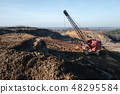 Excavator in the red clay quarry 48295584