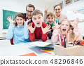 Funny class, students and teachers making faces 48296846