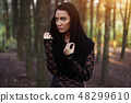 Young woman in the black blouse  48299610