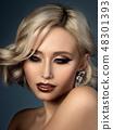 Portrait of beautiful woman with fashion make up 48301393