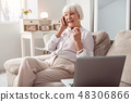 Pleasant elderly woman talking on the phone happily 48306866