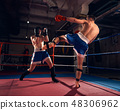 Boxers training kickboxing in the ring at the health club 48306962