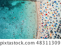 Aerial view of sandy beach with colorful umbrellas 48311309